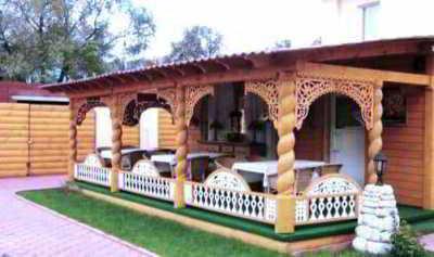 Оригинальный проект дома с террасой и верандой